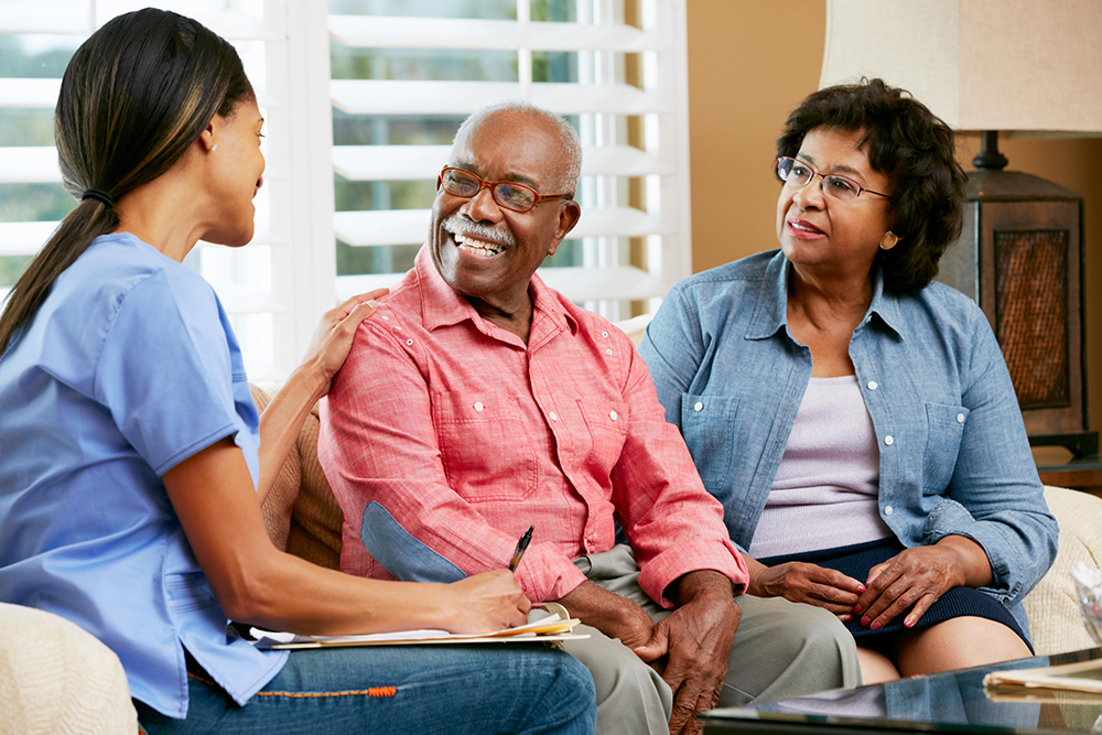 senior couple meeting with health nurse